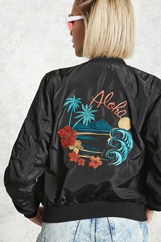f11c61af0efa4 A lightweight woven bomber jacket featuring front and back embroidery of  palm trees and tropical flowers