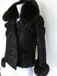 Black persian Lamb/Astrakhan fur jacket with fox details | From a collection of rare vintage coats and outerwear at https://www.1stdibs.com/fashion/clothing/coats-outerwear/