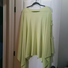Loose Fit Asymmetrical Poncho Tunic NWOT,  Never worn. Great with skinny jeans or Leggings Tops Tunics