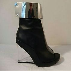 "Jeffrey Campbell ""Roni"" Leather Glass Wedge Boot This boot is FASHION!!  Designer Jeffrey Campbell Original Leather Glass look Wedge Heel. Made of genuine leather, It has a metallic silver plate above the ankle which gives the boot a very futuristic look, it features a front clear paneling with a peep toe opening and a lucite wedge heel. Heel Height: 5""...Platform Height:1""  They are practically new only worn once there are no visible signs of any wear and tear. Still in original box with…"