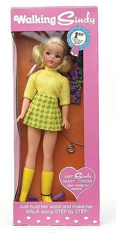 "12"" vinyl Walking Sindy doll in box, with additional floral coat dress and gold child-sized charm bracelet, United Kingdom, 1970, by Pedigree."