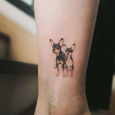 Chihuahua couple tattoo on the right ankle.