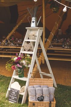 Stepladder Watering Can Sparklers Decor Blankets Colourful Outdoor Tipi Farm Wedding https://kirstymackenziephotography.co.uk/