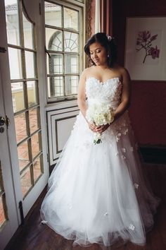 This plus size wedding dress has detachable flowers placed all over the gown. The flowers are high in density on the strapless bust line and then fade down the ball gown skirt.  The empire waist flatters the bodice.  See other plus size wedding dresses at http://www.dariuscordell.com/featured_item/plus-size-wedding-dresses-bridal-gowns/ (affordable custom designs & inexpensive replicas are options with our US based design firm)
