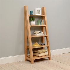 Vancouver Oak Ladder Bookcase 721.061 Quality wooden furniture at great low prices from PineSolutions.co.uk. Get Free Delivery and Exchanges on all orders. http://www.MightGet.com/january-2017-11/vancouver-oak-ladder-bookcase-721-061.asp