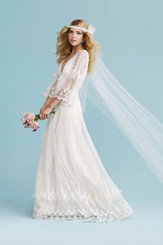 Calling Stevie Nicks: Thrill your inner flower child in this dreamy cotton dress with a guipure lace-embroidered tulle overlay featuring pretty flare sleeves and a deep V-neckline. Gown, about $2,450, by Claire Pettibone. Silk flower veil by Paris by Debra Moreland. Earrings by Roberta Chiarella. Bouquet by Zak Events.Photo Credit: Trevor Dixon/Hair: Jeanie Syfu using Tresemme/Makeup: Deborah Altizio using Armani Cosmetics