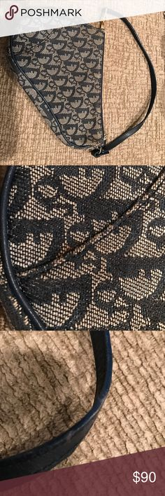 Christian Dior piano purse Authentic Christian Dior piano purse in used condition. A small stain(pictured) and some wear on the strap(also pictured). Christian Dior Bags Shoulder Bags