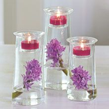 beautiful glass Symmetry Trio by PartyLite Candles & Gifts, with purple flowers, green leaves, vases