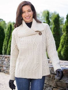 Women's Irish Merino Wool Sweater: Artfully knitted in a patchwork of traditional Aran diamond and cable stitches, both thought to symbolize good luck and good fortune.