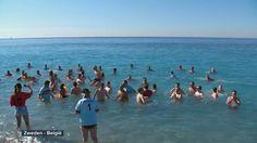 Belgische supporters nemen frisse duik in Middellandse Zee