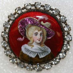 Ca. mid 19th c. metal, enamel (with magenta foil), and paste button.