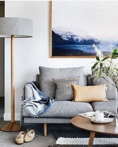 A lovely living room by Berkeley Interiors with our Tan Tab cushion on the classic Nook sofa by Jardan.