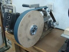 "Homemade grinder contact wheel constructed from MDF and measuring 14.375"" in diameter"