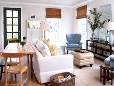 A sofa, covered in easy-care fabric, is grouped with two comfortable chairs to create a cozy seating arrangement in the combined living and dining area. A narrow table doubles as a work surface and dining table. The bench tucks under the table to save space. (Photo: Robbie Caponetto; Rex Perry)