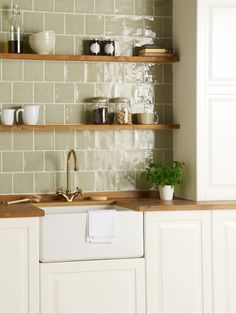 tiles Backsplash Green tiles are the perfect accessory to a country farmhouse kitchen. These 'Mere' tiles from The Winchester Tile Company are a subtle nod to the green tile trend and look gorgeous when paired with natural woods and foliage. Kitchen Wall Tiles Design, Country Kitchen Tiles, Country Kitchen Designs, Farmhouse Style Kitchen, Modern Farmhouse Kitchens, Kitchen Modern, Green Kitchen Walls, Rustic Kitchen, Country Kitchen Inspiration