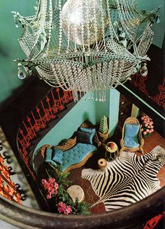 James Coburn's house designed by Tony Duquette. Zebra skin rug, turquoise silk upholstery and walls, a coral iron railing and a chandelier built around a disco mirror ball. Zebra Skin Rug, Zebra Rugs, Appartement Design, Interior And Exterior, Interior Design, Interior Decorating, Mirror Ball, Décor Boho, Bohemian Gypsy