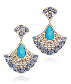 {Turquoise Fan Earrings} {These fun and uniquely shaped earrings are composed of 11.98 carats of turquoise, 12.79 carats of rose cut sapphires, and 5.22 carats of round brilliant diamonds.} Cellini Jewelers
