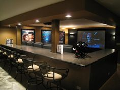 Arcade room behind the bar top? Fit a lot of people both along the bar for sporting events!! #mancave
