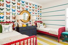 Colorful Shared Girls Room with Butterfly Wallpaper - what a beautiful, bold space for little girls!