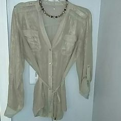 Gold with a little shine. Size medium. ??Tie waist, Gold with light sheen. Sleeves can Be full lenght or rolled 3/4 then buttoned. Gorgeous!!! Tops Blouses