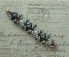 Yesterday I came across the bracelet photo below on Pinterest but it didn't link to a website. So, I have no idea who made the bracelet or if there is a pattern for it anywhere. I think it's a cute de