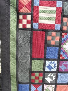 Interesting idea to use pieced blocks and then highlight solid blocks with quilting
