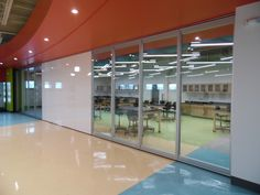 Modernfold designs, manufactures and services operable partitions, moveable glass walls, and accordion partitions.