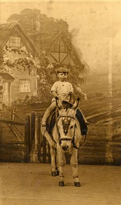 On a donkey in Blackpool. Found image. Photographed by Charles Howell   official photographer Blackpool Pleasure Beach Vintage photo.       Courtesy: LovedayLemon. Norwich, England (UK).