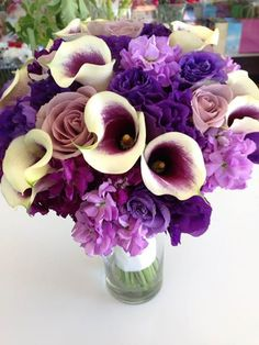 rich purple hue bouquet. calla lilies, lisianthus, stock and rose.
