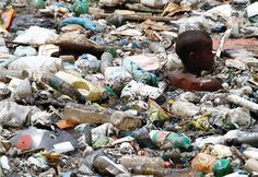 The Brazilian Slum Children Who Are Literally Swimming in Garbage #brazil #travel