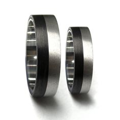 Carbon Fiber & Titanium Wedding Rings by Rosler on Etsy, $253.00 - Ryan loves this one.