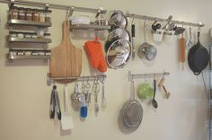 Space-saving wall-mounted S hooks used for kitchen storage in a tiny home.