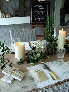 Christmas table setting - simple & natural....rosemary in a mason jar, gift wrap & placecards made of hymns...beautiful!