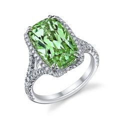 2013 JCK Jewelers' Choice Awards Winner: Best Platinum Jewelry over $10,000: Omi Privé handcrafted platinum ring features a rare 7.10 ct. tsavorite cushion-cut center stone, accented with 0.85 cts. t.w. ideal-cut diamond rounds; $52,500 #OmiPrive #tsavorite #diamonds #JCK