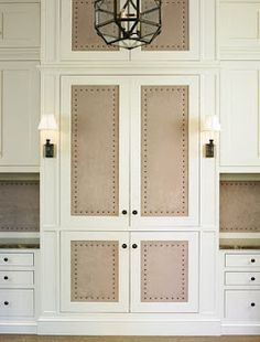 Suede paneled doors with French brass tacks. Suede paneled doors with French brass tacks. Ivory Kitchen Cabinets, Bathroom Cabinets, Hill Interiors, Closet Doors, Hall Closet, Panel Doors, Built Ins, Home Projects, Armoire