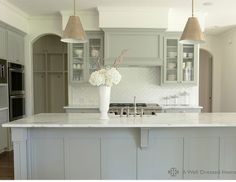 In love with the sink/island marble combination and the herringbone pattern of the subway tile! ~cll