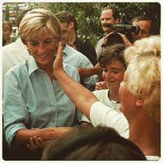 """8 August 1997: A Bosnian woman from the town of Tuzla touches the cheek of Diana, who arrived for a three-day visit to Bosnia as part of her global campaign against landmines ■"