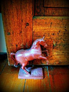 Antique horse statue holds the ancient door w/wood pegs open in one of the Kentucky Horse Farms I showed to a client. The details of these legendary farms amaze me.  #lizetterealty #lizette Fitzpatrick