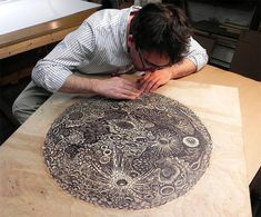 Since 2006 Pittsburgh-based husband and wife Paul Roden and Valerie Lueth have run the Tugboat Printshop, a traditional printmaking studio where everything is made by hand, starting with the giant slabs of wood into which each of their images are carved. The Moon is their largest hand-carved relief print ever coming in at 36″ x 32″ and will printed using two colors.