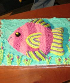 Fish Cake~~Two layers of cake and tons of bright frosting make this fish lots of fun.~~ I would do a sheet cake 'ocean' and fish on top of that.