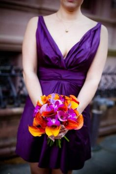 I don't like the dress but I like how the corals and purple contrasts each other. This is the shade of purple I would like if I have a fall wedding.