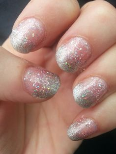 Natural glitter french nail art design. Light pink glitter coat with silver sparkle tip and glitter top coat.