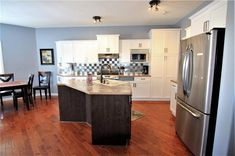 Kitchen with tons of white cabinets & ample counter space with beautiful back splash. Diamond Realty & Associates Ltd. Selling Real Estate, Counter Space, White Cabinets, Home Buying, Open House, Diamond, Kitchen, Beautiful, Home Decor
