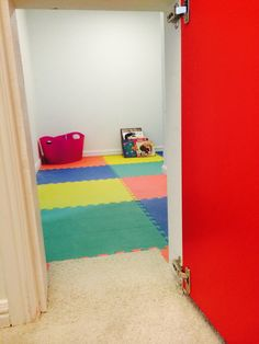 Through the red door.  I used some thick foam puzzle squares as the flooring so it's gentle on little (and big:-) knees.