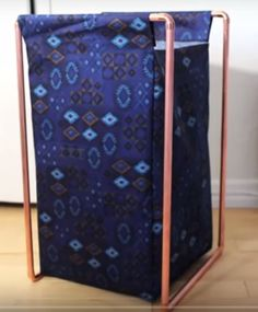 DIY copper pipe laundry basket(the sorry girls on youtube) - Half the height with dark grey fabric