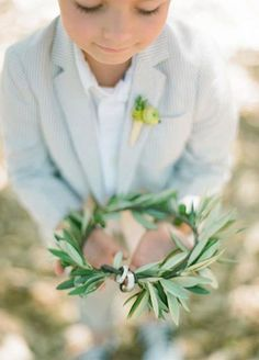 In many cultures, the branch is a deep-rooted symbol. Though the exchange of rings is not a tradition in a Greek wedding, having the rings brought out on an olive branch is a great way to put a modern spin on old traditions. 4 Modern Ideas For Exchanging Rings Beyond The Velvet Pillow