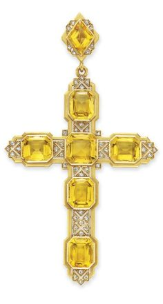 MELLERIO - AN ANTIQUE CITRINE AND DIAMOND CROSS PENDANT, CIRCA 1900. Designed as a cross, set with six rectangular-cut citrines, enhanced by rose-cut diamond detail, to the lozenge-shaped surmount of similar design, with concealed compartment on the reverse, mounted in 18k gold, with French assay marks and maker's marks. Signed Mellerio, R. Paix, no. 182.