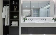 Marylebone Apartment | Laura Hammett like the idea of space in the bathroom to hang robes