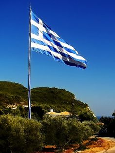 Keri cape Zakynthos Island, Greece - The largest Greek flag. Guiness world records: x = In the background is Keri lighthouse. Karpathos Greece, Greek Flag, Greek Isles, Greece Islands, Paros, World Records, Greece Travel, Holiday Destinations, Lighthouses