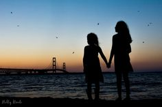 silhouette of two children by Holly Awwad